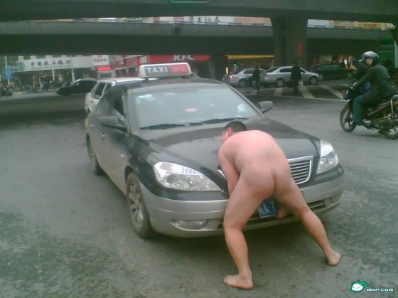 Nude Chinese man holding up an Anhui taxi