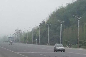 Plane landing on near-empty road in Beichuan, Sichuan