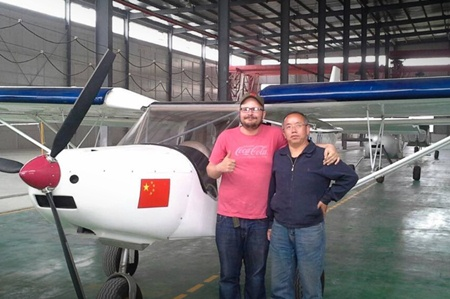 A foreign pilot and his company's CEO at a Sichuan gas station.